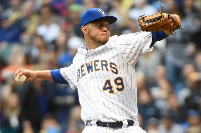 May 9, 2014; Milwaukee, WI, USA;  Milwaukee Brewers pitcher Yovani Gallardo (49) pitches in the first inning against the New York Yankees at Miller Park. Mandatory Credit: Benny Sieu-USA TODAY Sports