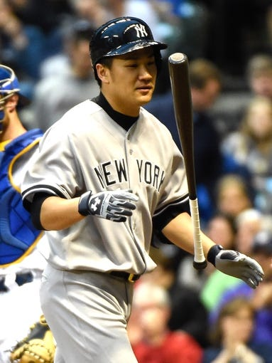 May 9, 2014; Milwaukee, WI, USA; New York Yankees pitcher Masahiro Tanaka (19) reacts after striking out in the first inning in his first major league at bat during the game against the Milwaukee Brewers at Miller Park. Mandatory Credit: Benny Sieu-USA TODAY Sports
