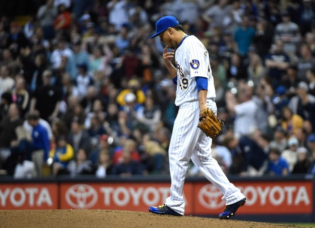 May 9, 2014; Milwaukee, WI, USA;  Milwaukee Brewers pitcher Yovani Gallardo (49) reacts after giving up a 3-run home run to New York Yankees third baseman Yangervis Solarte (not pictured) in the fourth inning at Miller Park. Mandatory Credit: Benny Sieu-USA TODAY Sports