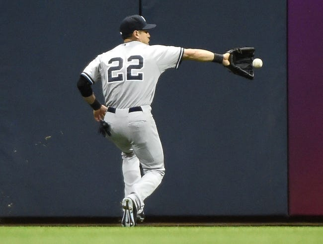 May 9, 2014; Milwaukee, WI, USA;  New York Yankees center fielder Jacoby Ellsbury (22) can't get ball hit by Milwaukee Brewers center fielder Carlos Gomez (not pictured) that fell for a double in the sixth inning at Miller Park. Mandatory Credit: Benny Sieu-USA TODAY Sports