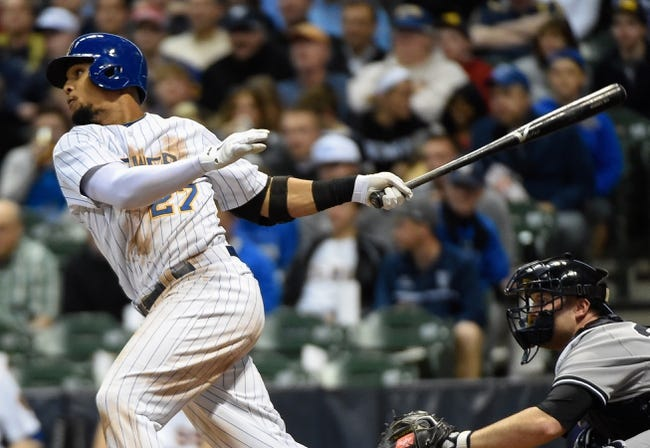 May 9, 2014; Milwaukee, WI, USA;  Milwaukee Brewers center fielder Carlos Gomez (27) hits a double in the sixth inning during the game against the New York Yankees at Miller Park. Mandatory Credit: Benny Sieu-USA TODAY Sports
