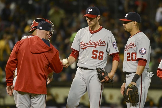 May 9, 2014; Oakland, CA, USA; Washington Nationals manager Matt Williams (9, far left) receives the baseball from starting pitcher Doug Fister (58) in a pitching change against the Oakland Athletics during the fifth inning at O.co Coliseum. Mandatory Credit: Kyle Terada-USA TODAY Sports