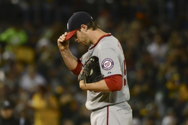 May 9, 2014; Oakland, CA, USA; Washington Nationals starting pitcher Doug Fister (58) reacts after giving up a two-run home run to Oakland Athletics first baseman Brandon Moss (37, not pictured) during the fifth inning at O.co Coliseum. Mandatory Credit: Kyle Terada-USA TODAY Sports