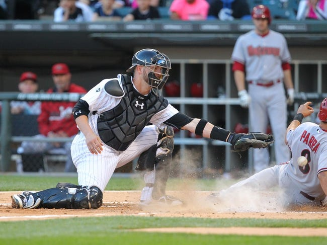 May 10, 2014; Chicago, IL, USA; Arizona Diamondbacks right fielder Gerardo Parra (8) slides in safely under the tag of Chicago White Sox catcher Tyler Flowers (21) during the fifth inning at U.S Cellular Field. Mandatory Credit: Dennis Wierzbicki-USA TODAY Sports