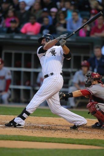 May 10, 2014; Chicago, IL, USA; Chicago White Sox first baseman Paul Konerko (14) hits a 2 run home run during the fifth inning against the Arizona Diamondbacks at U.S Cellular Field. Mandatory Credit: Dennis Wierzbicki-USA TODAY Sports