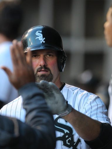 May 10, 2014; Chicago, IL, USA; Chicago White Sox first baseman Paul Konerko (14) celebrates with teammates after hitting a 2 run home run during the fifth inning against the Arizona Diamondbacks at U.S Cellular Field. Mandatory Credit: Dennis Wierzbicki-USA TODAY Sports
