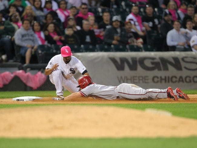 May 10, 2014; Chicago, IL, USA; Arizona Diamondbacks shortstop Chris Owings (16) is tagged out at third base by Chicago White Sox third baseman Marcus Semien (5) during the seventh inning at U.S Cellular Field. Mandatory Credit: Dennis Wierzbicki-USA TODAY Sports