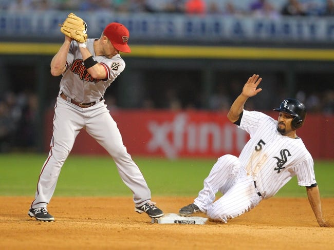 May 10, 2014; Chicago, IL, USA; Chicago White Sox third baseman Marcus Semien (5) is out at second with Arizona Diamondbacks second baseman Aaron Hill (2) taking the throw during the sixth inning at U.S Cellular Field. Mandatory Credit: Dennis Wierzbicki-USA TODAY Sports