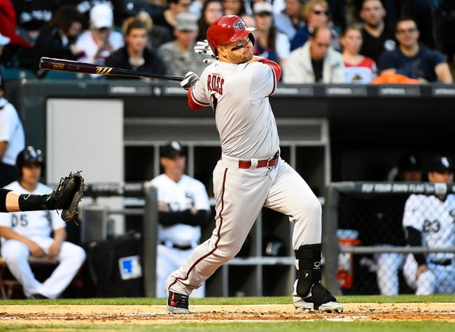 May 9, 2014; Chicago, IL, USA; Arizona Diamondbacks left fielder Cody Ross (7) hits a single against the Chicago White Sox during the third inning at U.S Cellular Field. Mandatory Credit: Mike DiNovo-USA TODAY Sports