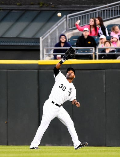 May 9, 2014; Chicago, IL, USA; Chicago White Sox left fielder Alejandro De Aza (30) during the fourth inning at U.S Cellular Field. Mandatory Credit: Mike DiNovo-USA TODAY Sports