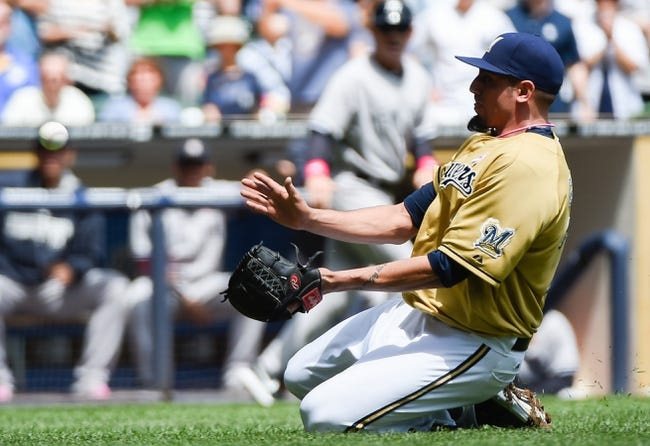 May 11, 2014; Milwaukee, WI, USA;  Milwaukee Brewers pitcher Matt Garza (22) catches a bunt attempt by New York Yankees shortstop Derek Jeter (not pictured) in the first inning at Miller Park. Mandatory Credit: Benny Sieu-USA TODAY Sports