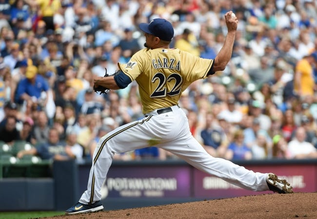 May 11, 2014; Milwaukee, WI, USA; Milwaukee Brewers pitcher Matt Garza (22) throws the ball against the New York Yankees in the first inning at Miller Park. Mandatory Credit: Benny Sieu-USA TODAY Sportsa