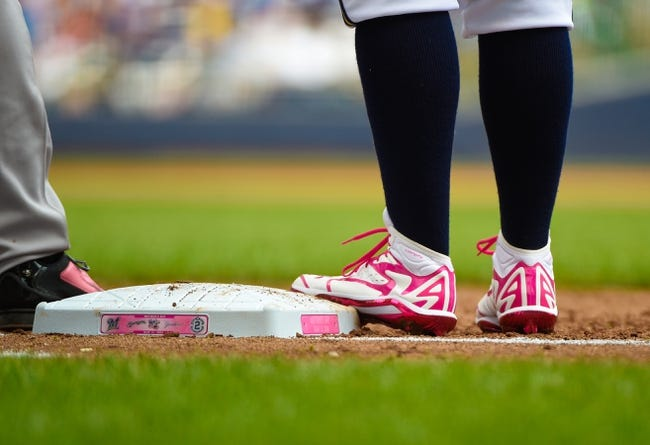 May 11, 2014; Milwaukee, WI, USA; Milwaukee Brewers first baseman Mark Reynolds (7) wears pink cleats to honor Mother's Day against the New York Yankees at Miller Park. Mandatory Credit: Benny Sieu-USA TODAY Sports
