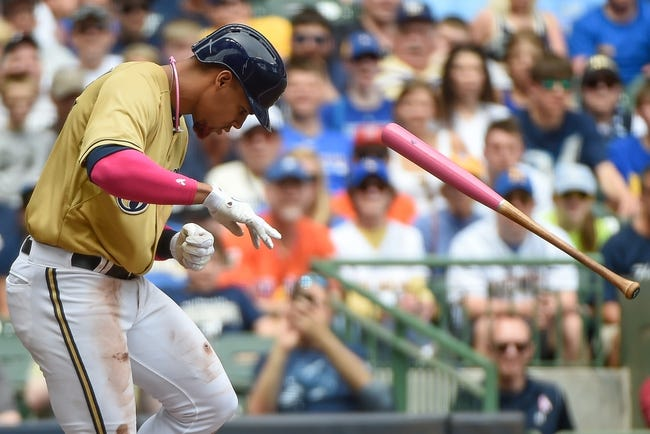 May 11, 2014; Milwaukee, WI, USA; Milwaukee Brewers center fielder Carlos Gomez (27) reacts after being hit by a pitch in the third inning during against the New York Yankees at Miller Park. Mandatory Credit: Benny Sieu-USA TODAY Sports