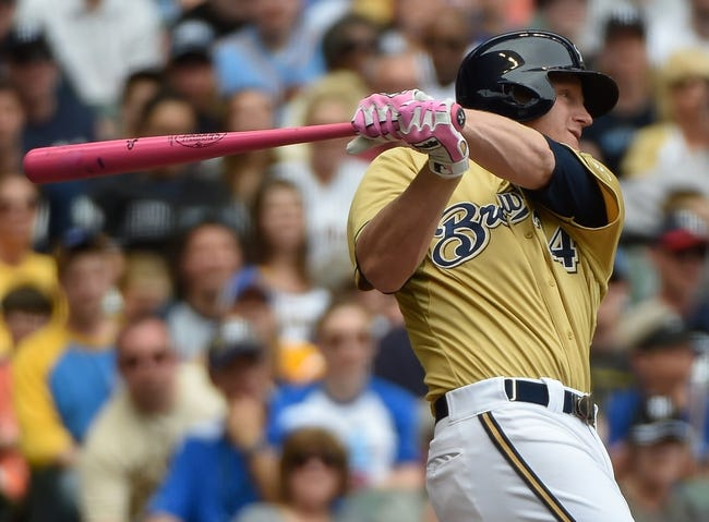 May 11, 2014; Milwaukee, WI, USA; Milwaukee Brewers first baseman Lyle Overbay (24) hits a single to drive in a run in the third inning against the New York Yankees at Miller Park. Mandatory Credit: Benny Sieu-USA TODAY Sports