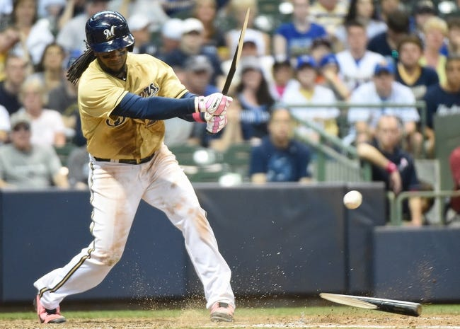 May 11, 2014; Milwaukee, WI, USA; Milwaukee Brewers second baseman Rickie Weeks (23) breaks his bat while hitting a double in the ninth inning against the New York Yankees at Miller Park. Mandatory Credit: Benny Sieu-USA TODAY Sports