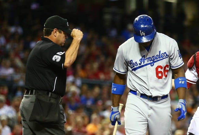Sept. 17, 2013; Phoenix, AZ, USA: Los Angeles Dodgers outfielder Yasiel Puig (66) reacts after being called out on strikes by umpire Rob Drake against the Arizona Diamondbacks at Chase Field. Mandatory Credit: Mark J. Rebilas-USA TODAY Sports