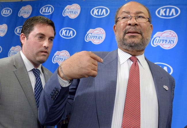 May 12, 2014; Los Angeles, CA, USA; Los Angeles Clippers vice president of communications Seth Burton (left) escorts Dick Parson out of a press conference to introduce Parsons as interim chief executive officer at Staples Center. Mandatory Credit: Kirby Lee-USA TODAY Sports