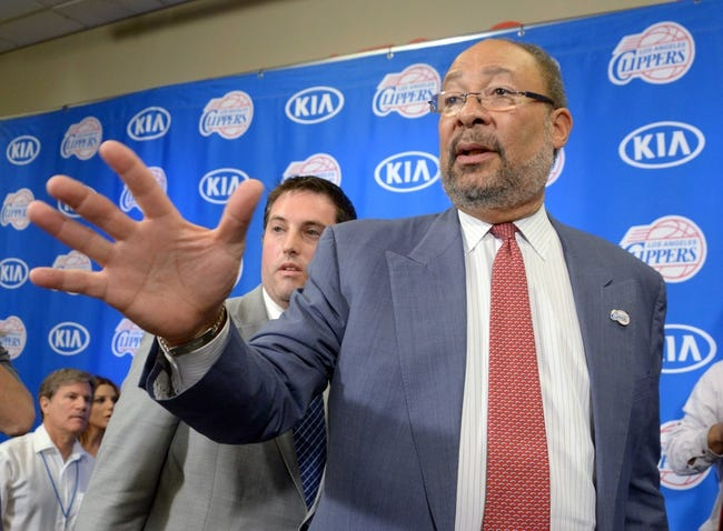 May 12, 2014; Los Angeles, CA, USA; Los Angeles Clippers vice president of communications Seth Burton (left) escorts Dick Parson out of press conference introducing Parsons as interim chief executive officer at Staples Center. Mandatory Credit: Kirby Lee-USA TODAY Sports