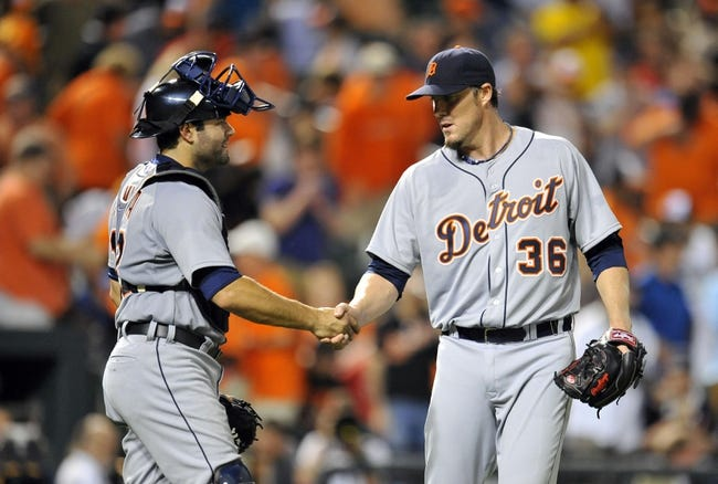 May 12, 2014; Baltimore, MD, USA; Detroit Tigers catcher Alex Avila (13) congratulates pitcher Joe Nathan (36) after a game against the Baltimore Orioles at Oriole Park at Camden Yards. The Tigers defeated the Orioles 4-1. Mandatory Credit: Joy R. Absalon-USA TODAY Sports