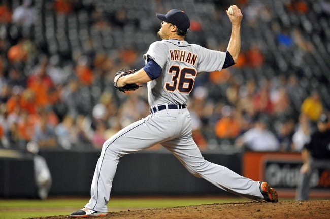 May 12, 2014; Baltimore, MD, USA; Detroit Tigers pitcher Joe Nathan (36) pitches in the ninth inning against the Baltimore Orioles at Oriole Park at Camden Yards. The Tigers defeated the Orioles 4-1. Mandatory Credit: Joy R. Absalon-USA TODAY Sports