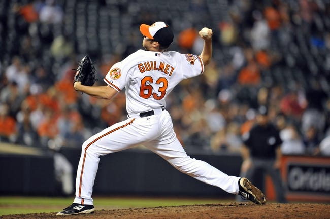 May 12, 2014; Baltimore, MD, USA; Baltimore Orioles pitcher Preston Guillmet (63) throws in the ninth inning against the Detroit Tigers at Oriole Park at Camden Yards. The Tigers defeated the Orioles 4-1. Mandatory Credit: Joy R. Absalon-USA TODAY Sports
