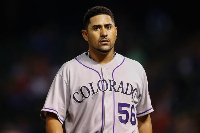 May 8, 2014; Arlington, TX, USA; Colorado Rockies starting pitcher Franklin Morales (56) reacts during the game against the Texas Rangers at Globe Life Park in Arlington. Texas won 5-0. Mandatory Credit: Kevin Jairaj-USA TODAY Sports