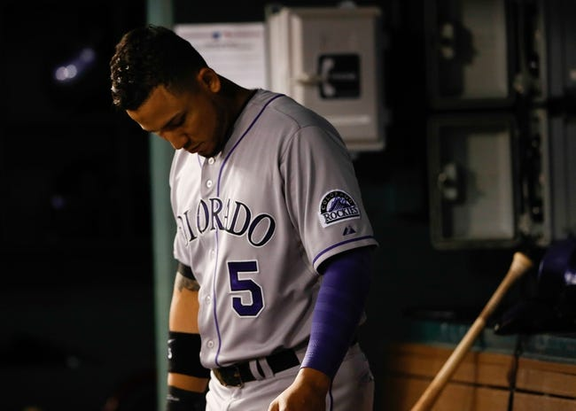 May 8, 2014; Arlington, TX, USA; Colorado Rockies designated hitter Carlos Gonzalez (5) reacts in the dugout during the game against the Texas Rangers at Globe Life Park in Arlington. Texas won 5-0. Mandatory Credit: Kevin Jairaj-USA TODAY Sports