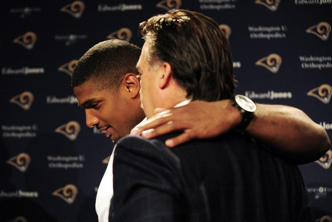 May 13, 2014; St. Louis, MO, USA; St. Louis Rams seventh round pick defensive end Michael Sam (left) talks with head coach Jeff Fisher during a press conference at Rams Park. Mandatory Credit: Jeff Curry-USA TODAY Sports