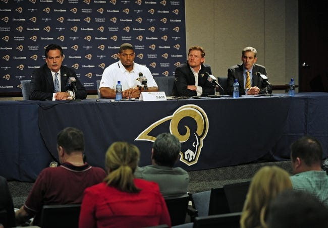 May 13, 2014; St. Louis, MO, USA; St. Louis Rams head coach Jeff Fisher (left), seventh round pick defensive end Michael Sam (second from left) , general manager Les Snead (second from right) and executive vice president Kevin Demoff talk with the media during a press conference at Rams Park. Mandatory Credit: Jeff Curry-USA TODAY Sports
