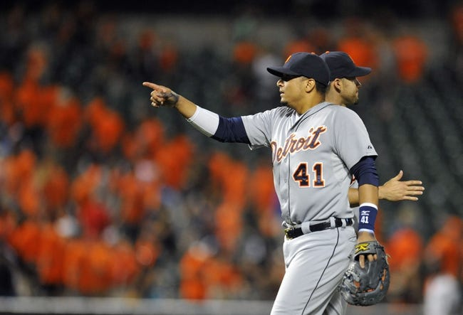 May 13, 2014; Baltimore, MD, USA; Detroit Tigers first baseman Victor Martinez (41) points towards Miguel Cabrera (not shown) after a game against the Baltimore Orioles at Oriole Park at Camden Yards. The Tigers defeated the Orioles 4-1. Mandatory Credit: Joy R. Absalon-USA TODAY Sports