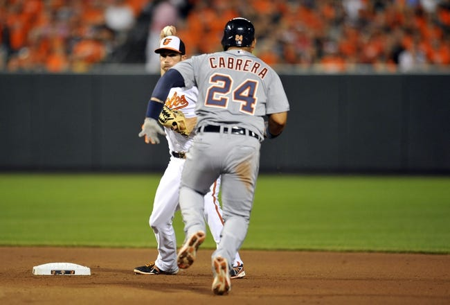May 13, 2014; Baltimore, MD, USA; Detroit Tigers designated hitter Miguel Cabrera (24) is out at second base as Baltimore Orioles shortstop J.J. Hardy (2) starts the double play in the seventh inning at Oriole Park at Camden Yards. The Tigers defeated the Orioles 4-1. Mandatory Credit: Joy R. Absalon-USA TODAY Sports