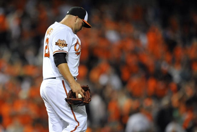 May 13, 2014; Baltimore, MD, USA; Baltimore Orioles pitcher Tommy Hunter (29) reacts after giving up a three-run home run to Detroit Tigers first baseman Miguel Cabrera (not shown) in the ninth inning at Oriole Park at Camden Yards. The Tigers defeated the Orioles 4-1. Mandatory Credit: Joy R. Absalon-USA TODAY Sports