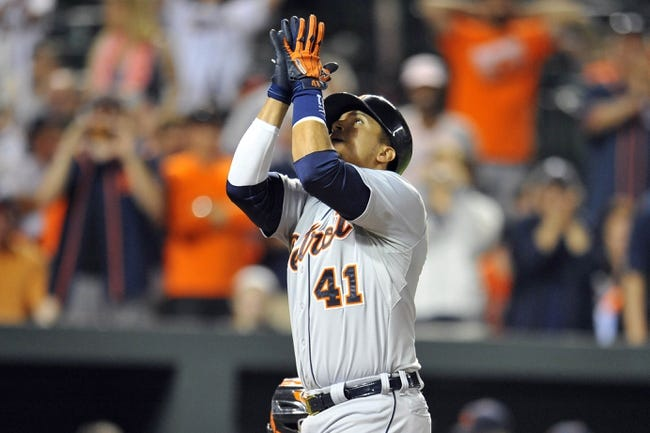 May 13, 2014; Baltimore, MD, USA; Detroit Tigers first baseman Victor Martinez (41) reacts once he crosses home plate after hitting a solo homer  run in the ninth inning against the Baltimore Orioles at Oriole Park at Camden Yards. The Tigers defeated the Orioles 4-1. Mandatory Credit: Joy R. Absalon-USA TODAY Sports