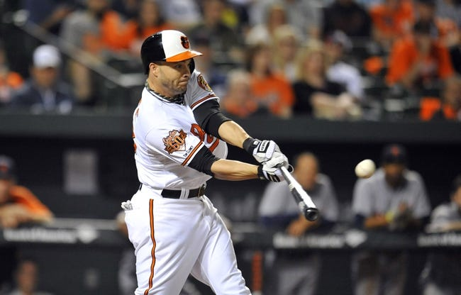 May 13, 2014; Baltimore, MD, USA; Baltimore Orioles designated hitter Steve Pearce (28) singles in the ninth inning against the Detroit Tigers at Oriole Park at Camden Yards. The Tigers defeated the Orioles 4-1. Mandatory Credit: Joy R. Absalon-USA TODAY Sports