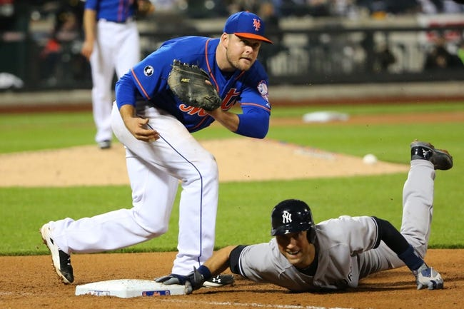 May 14, 2014; New York, NY, USA;  New York Yankees shortstop Derek Jeter (2) slides back to first as New York Mets first baseman Lucas Duda (21) is late to tag during the seventh inning at Citi Field. New York Yankees won 4-0.  Mandatory Credit: Anthony Gruppuso-USA TODAY Sports
