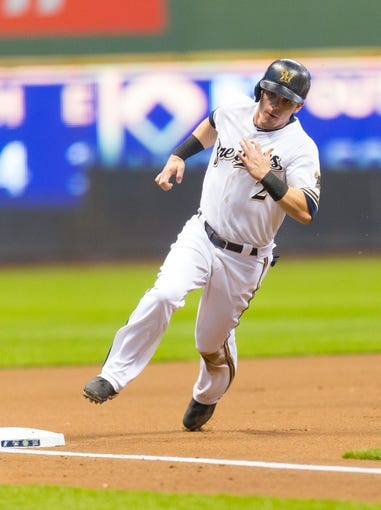 May 6, 2014; Milwaukee, WI, USA; Milwaukee Brewers second baseman Scooter Gennett (2) rounds third base during the game against the Arizona Diamondbacks at Miller Park.  Arizona won 7-5.  Mandatory Credit: Jeff Hanisch-USA TODAY Sports