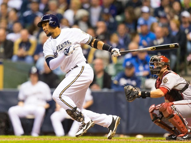 May 6, 2014; Milwaukee, WI, USA; Milwaukee Brewers center fielder Carlos Gomez (27) bats during the game against the Arizona Diamondbacks at Miller Park.  Arizona won 7-5.  Mandatory Credit: Jeff Hanisch-USA TODAY Sports