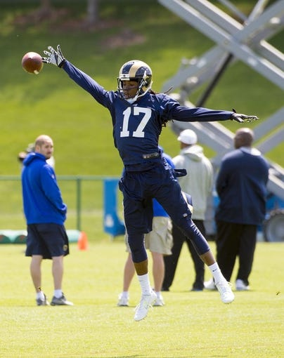 May 16, 2014; St. Louis, MO, USA; St. Louis Rams wide receiver Jamaine Sherman (17) leaps for an overthrown pass during rookie minicamp at Rams Park. Mandatory Credit: Scott Rovak-USA TODAY Sports
