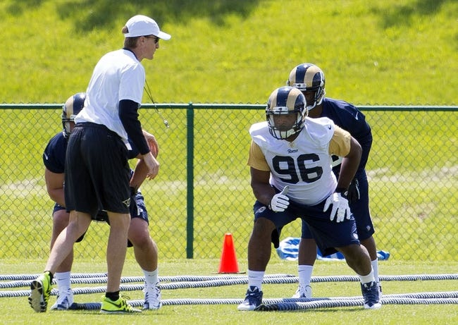 May 16, 2014; St. Louis, MO, USA; St. Louis Rams Special Teams Coordinator John Fassel watches defensive end Michael Sam (96) during minicamp at Rams Park. Mandatory Credit: Scott Rovak-USA TODAY Sports