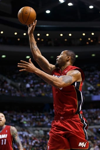 Mar 28, 2014; Auburn Hills, MI, USA; Miami Heat forward Rashard Lewis (9) shoots against the Detroit Pistons at The Palace of Auburn Hills. Mandatory Credit: Rick Osentoski-USA TODAY Sports