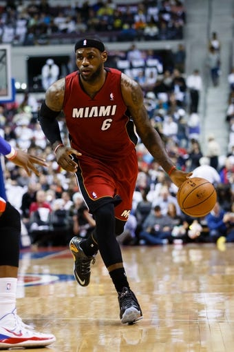 Mar 28, 2014; Auburn Hills, MI, USA; Miami Heat forward LeBron James (6) moves the ball against the Detroit Pistons at The Palace of Auburn Hills. Mandatory Credit: Rick Osentoski-USA TODAY Sports