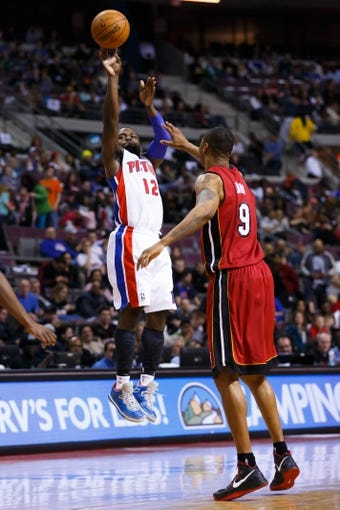 Mar 28, 2014; Auburn Hills, MI, USA; Detroit Pistons guard Will Bynum (12) shoots on Miami Heat forward Rashard Lewis (9) at The Palace of Auburn Hills. Mandatory Credit: Rick Osentoski-USA TODAY Sports