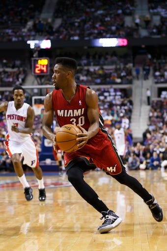 Mar 28, 2014; Auburn Hills, MI, USA; Miami Heat guard Norris Cole (30) moves the ball against the Detroit Pistons at The Palace of Auburn Hills. Mandatory Credit: Rick Osentoski-USA TODAY Sports