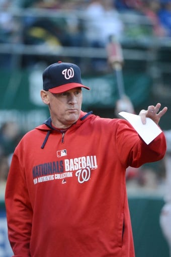 May 9, 2014; Oakland, CA, USA; Washington Nationals manager Matt Williams (9) signals during the first inning against the Oakland Athletics at O.co Coliseum. The Athletics defeated the Nationals 8-0.  Mandatory Credit: Kyle Terada-USA TODAY Sports
