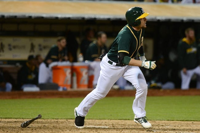 May 10, 2014; Oakland, CA, USA; Oakland Athletics shortstop Jed Lowrie (8) bats against the Washington Nationals during the ninth inning at O.co Coliseum. The Athletics defeated the Nationals 4-3 in 10 innings. Mandatory Credit: Kyle Terada-USA TODAY Sports
