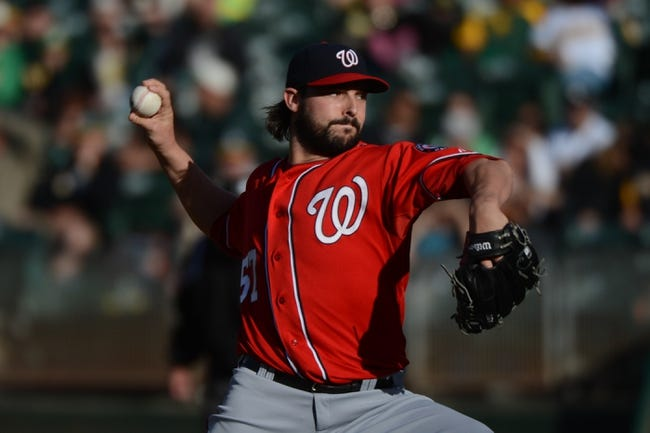 May 10, 2014; Oakland, CA, USA; Washington Nationals starting pitcher Tanner Roark (57) delivers a pitch against the Oakland Athletics during the first inning at O.co Coliseum. The Athletics defeated the Nationals 4-3 in 10 innings. Mandatory Credit: Kyle Terada-USA TODAY Sports
