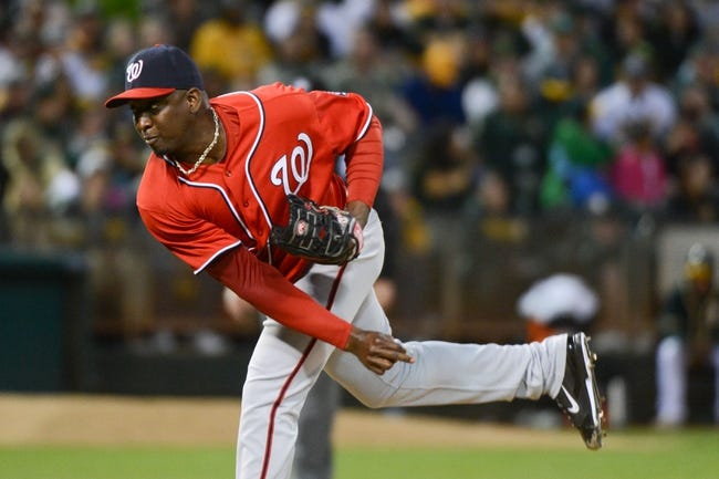 May 10, 2014; Oakland, CA, USA; Washington Nationals relief pitcher Rafael Soriano (29) delivers a pitch during the ninth inning against the Oakland Athletics at O.co Coliseum. The Athletics defeated the Nationals 4-3 in 10 innings. Mandatory Credit: Kyle Terada-USA TODAY Sports