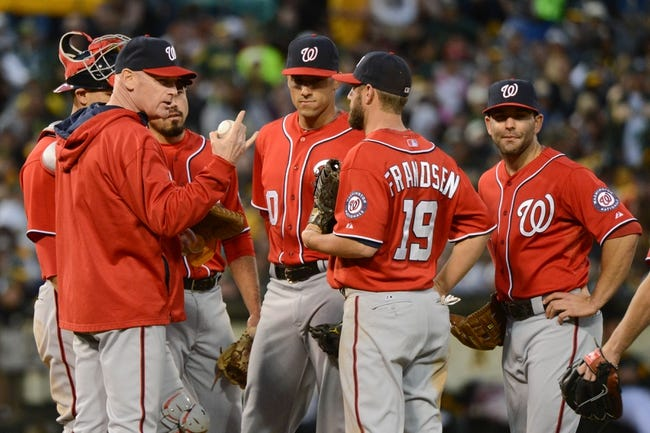 May 10, 2014; Oakland, CA, USA; Washington Nationals manager Matt Williams (9, far left) stands on the mound with the infield during a pitching change during the eighth inning against the Oakland Athletics at O.co Coliseum. The Athletics defeated the Nationals 4-3 in 10 innings. Mandatory Credit: Kyle Terada-USA TODAY Sports