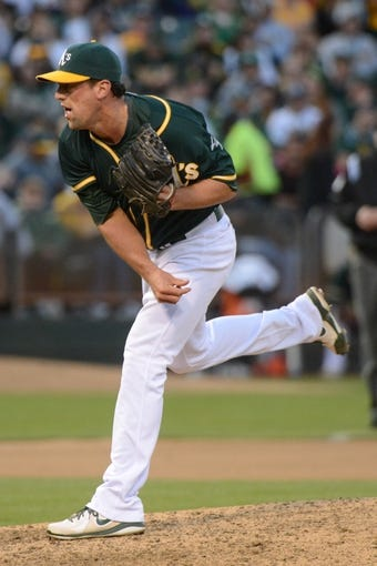 May 10, 2014; Oakland, CA, USA; Oakland Athletics relief pitcher Luke Gregerson (44) delivers a pitch against the Washington Nationals during the eighth inning at O.co Coliseum. The Athletics defeated the Nationals 4-3 in 10 innings. Mandatory Credit: Kyle Terada-USA TODAY Sports